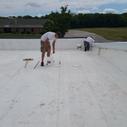 Preparing to apply silicone roof coating